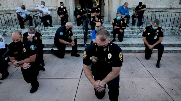Why some police officers stood with protesters outraged over George Floyd's death