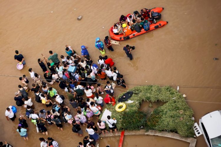 Tens of thousands evacuated from floods in China